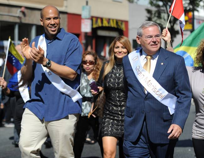 U.S. Sens. Cory Booker, left, and Robert Menendez march in New Jersey's 39th Annual Hispanic Parade Sunday.